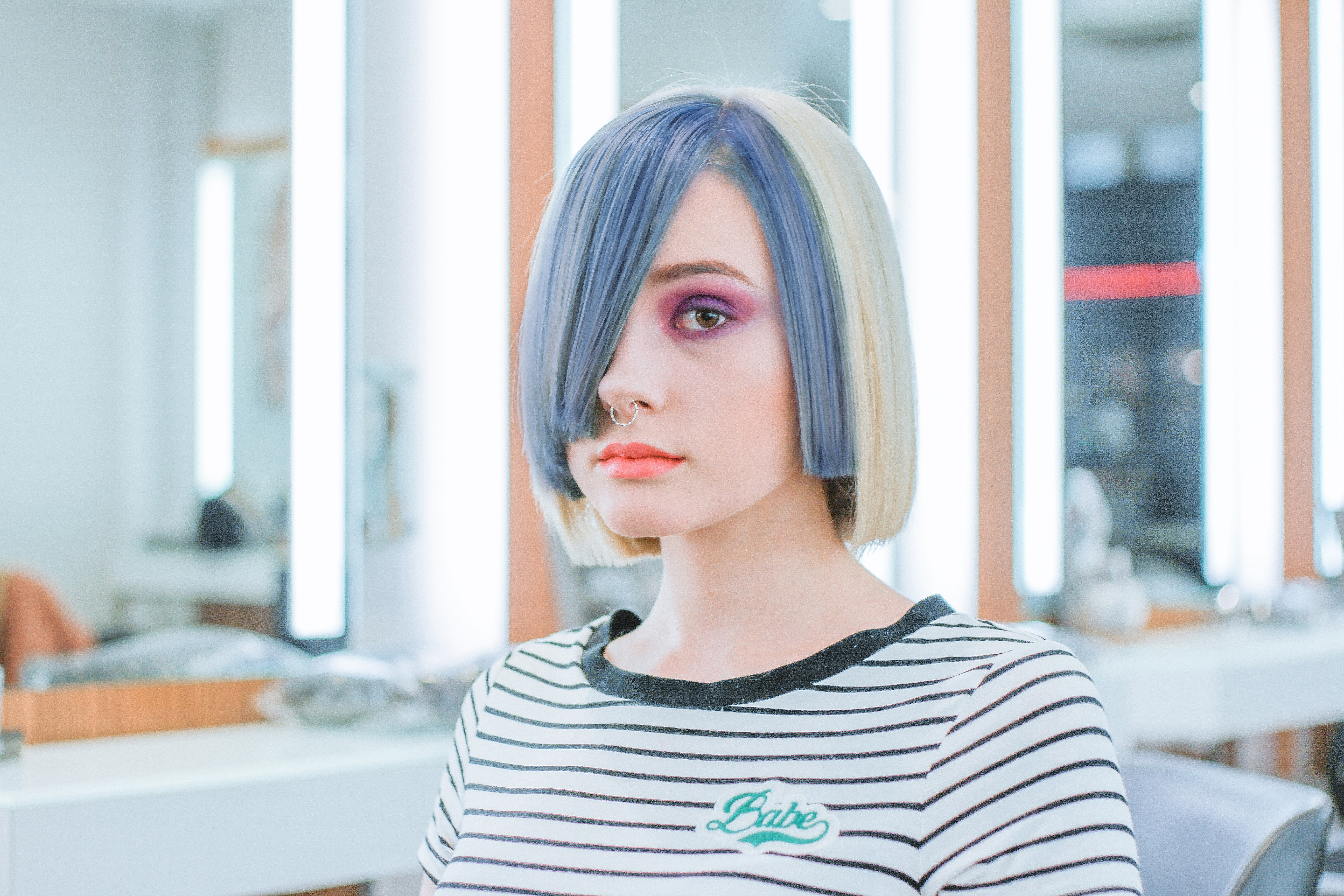 A girl with colourful hair leaving the salon