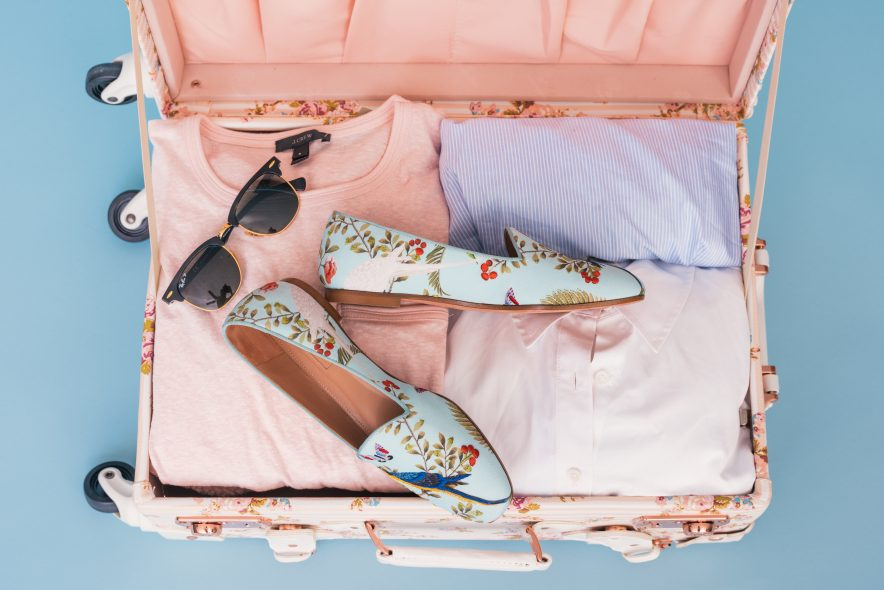 A suitcase packed for a holiday